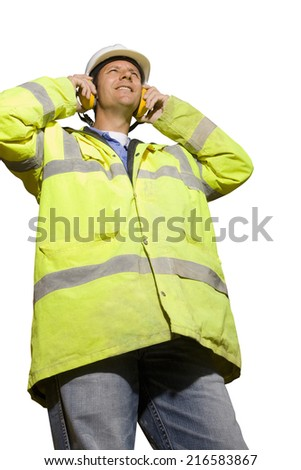 Construction worker in hard-hat, headphones and reflector jacket - stock photo