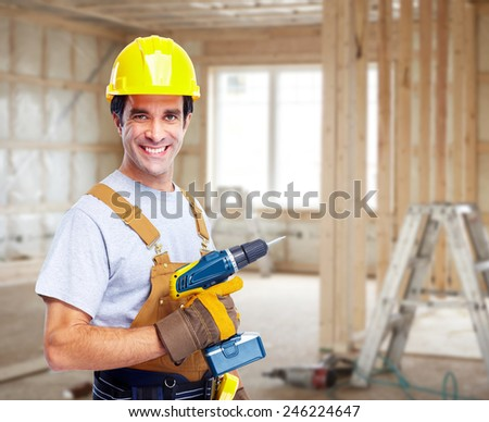 Construction worker in  new house. Renovation background. - stock photo