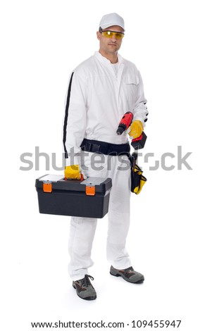 construction worker in white coveralls with a tool box on a whit - stock photo