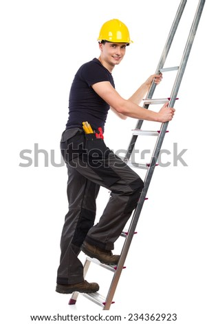 Construction worker in yellow helmet climbing a ladder. Full length studio shot isolated on white. - stock photo