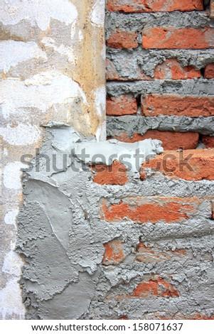 Construction worker laying bricks - stock photo
