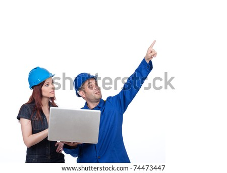 Construction worker pointing up isolated on white background - stock photo