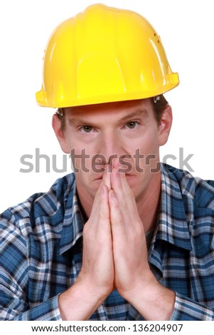 Construction worker praying - stock photo