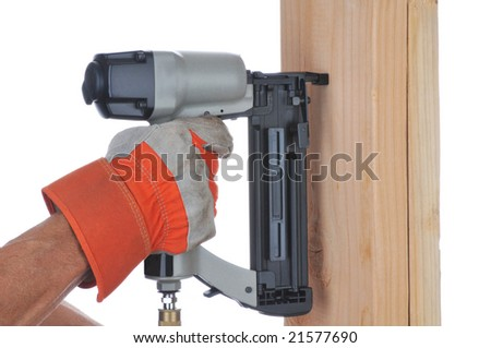 Construction Worker's hand with nail gun and boards isolated over white - stock photo