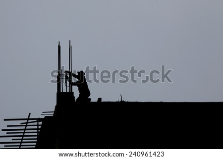Construction worker silhouette. - stock photo