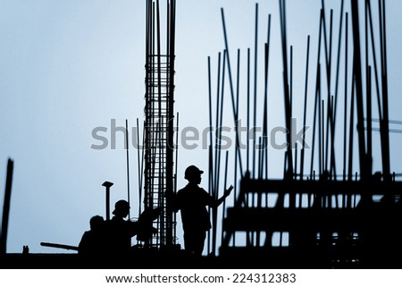 construction worker silhouette on the work place - stock photo