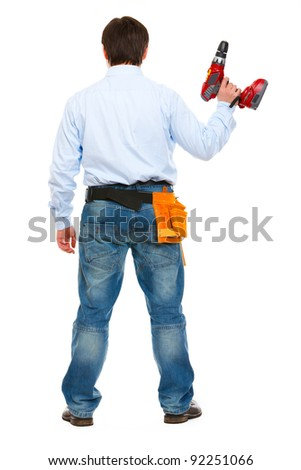 Construction worker standing  back to camera - stock photo