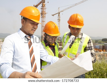Construction worker team work discussion on location - stock photo