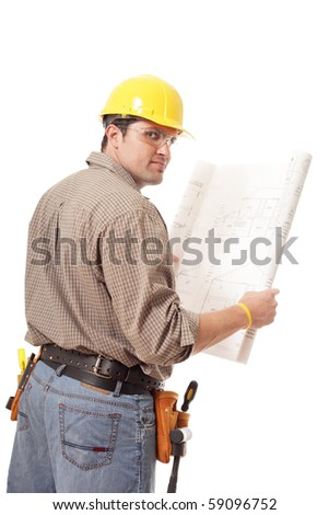 Construction worker turning around while holding blueprints - stock photo