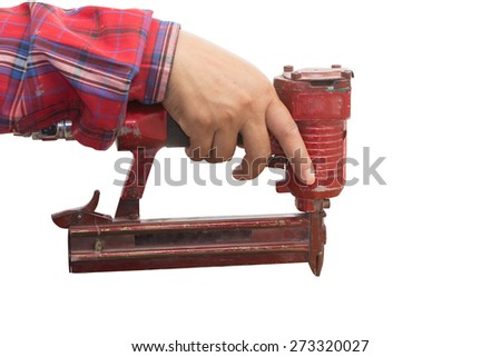 Construction Worker using a The old Nail Gun - isolated over white - stock photo