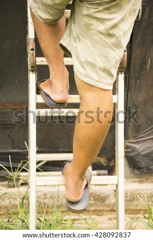 Construction worker was up a ladder roof repair.Background for work and home. - stock photo