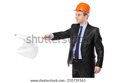 Construction worker waving a white flag isolated on white background - stock photo