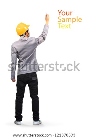 Construction worker wearing a helmet and sketching on whiteboard, ( back view ) isolated on white background With Clipping Paths for design work - stock photo