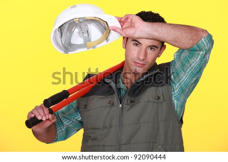 Construction worker wiping his brow - stock photo