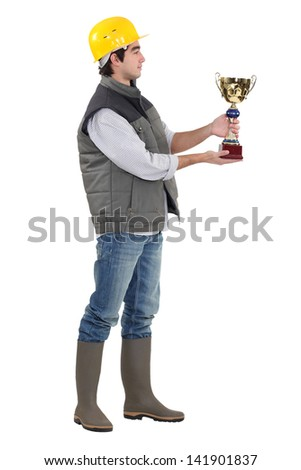 Construction worker with an award - stock photo