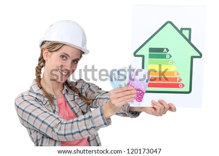 Construction worker with cash - stock photo