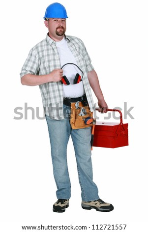 Construction worker with ear defenders - stock photo