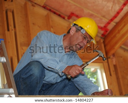Construction Worker With Hammer - stock photo