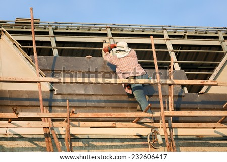 Construction worker working on construction site - stock photo