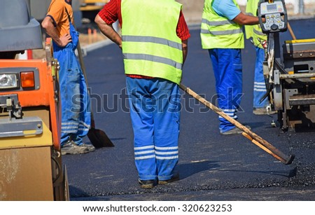 Construction workers at the road construction - stock photo