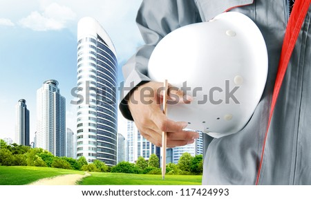 Construction workers dream city - stock photo