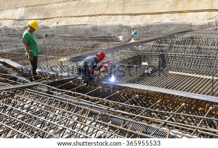 Construction workers in work, in the construction site  - stock photo