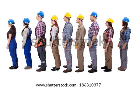 Construction workers standing in queue. Isolated on white - stock photo
