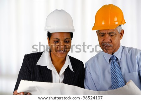 Construction workers working on a job together - stock photo