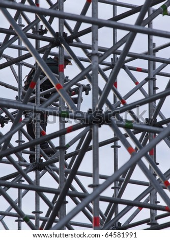 Constructive work builds on a metal stand structure. - stock photo