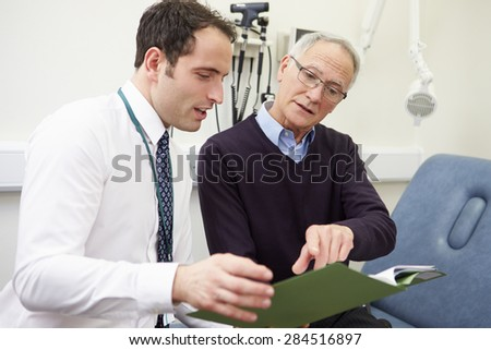 Consultant Discussing Test Results With Patient - stock photo