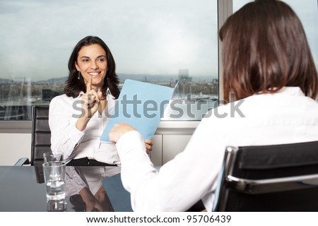Consultation with female financial adviser in a nice office - stock photo