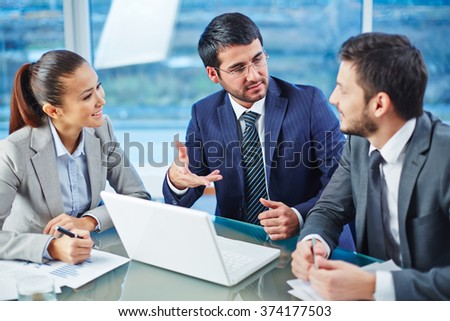 Consulting with colleague - stock photo