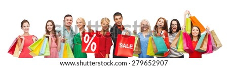 consumerism, people and discount concept - group of happy people with percentage and sale sign on shopping bags - stock photo