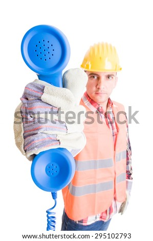 Contact, assistance support construction company concept with contractor holding a phone - stock photo