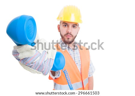Contact person or assistance for construction company giving the phone as call us gesture - stock photo