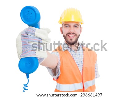 Contact person or support for construction company holding the phone - stock photo