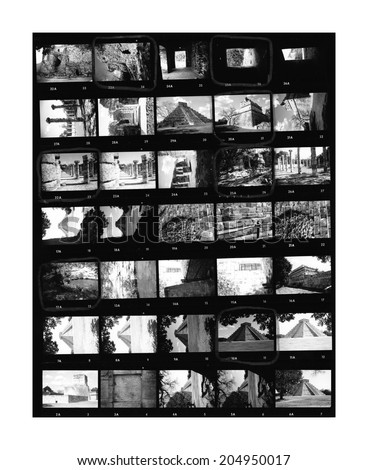 Contact sheet of old black and white film negatives on traditional photo paper - stock photo