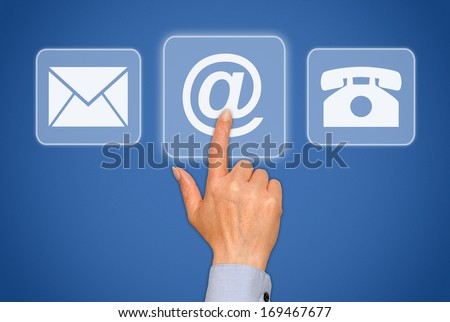 Contact us - blue touchscreen with female hand - stock photo