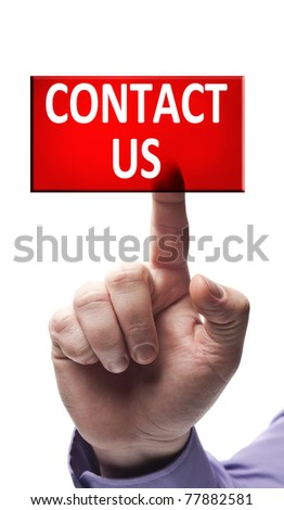Contact us button pressed by male hand - stock photo