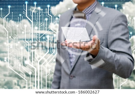 Contact us concept, businessman receiving mail from the cloud. - stock photo