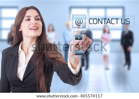 Contact us concept with business woman pressing transparent futuristic button on digital display or touch screen - stock photo