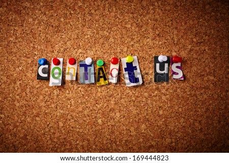 Contact us - Cut out letters pinned on a cork notice board.  - stock photo