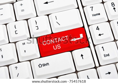 Contact us key in place of enter key - stock photo