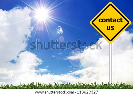 Contact us on yellow road warning sign - stock photo