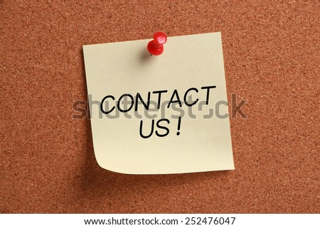 Contact Us sticky note pinned on cork. - stock photo