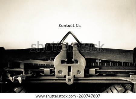 Contact US , website design , vintage typewriter - stock photo