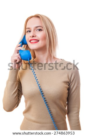Contact us woman concept with a female talking on the phone and looking into the camera - stock photo
