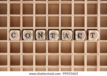 Contact word construction with letter blocks / cubes and a shallow depth of field - stock photo