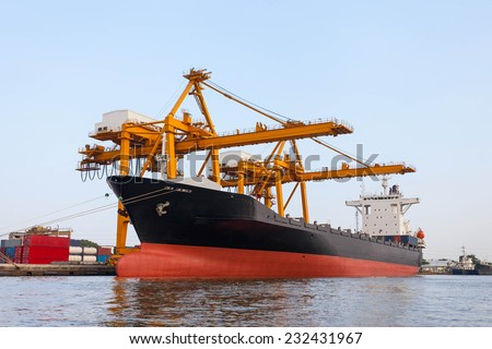 Container Cargo freight ship dock  in sea port - stock photo