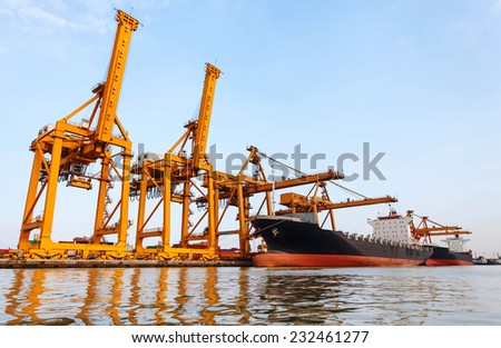 Container Cargo freight ship  in sea port - stock photo